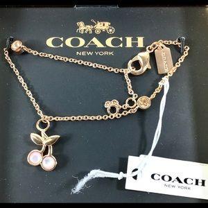 Coach New in box gold tone Cherry bracelet